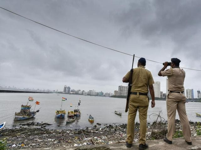 A police commando stands guard by the sea coast at Geeta Nagar Colaba, after a high alert was issued, in Mumbai, India, September 23, 2016