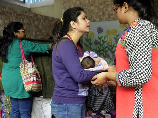 Students, teachers and employees of Gokhale Memorial Girls School, located bang opposite the SSKM Hospital where a fire broke out on Monday morning, came forward to provide shelter and guard the privacy of a group of mothers who panicked and ran across the street clutching their newborns.