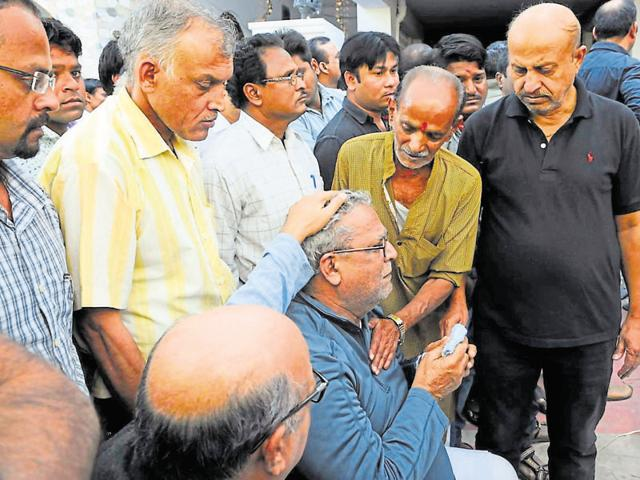 Relatives console father of RKDF vice chairman Rajesh Singh, in Bhopal on Monday.