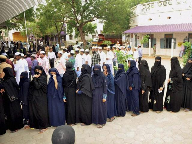 Voters queue to caste their vote for the bypoll of Aravakurichi assembly in Karur District, Tamil Nadu on Saturday.