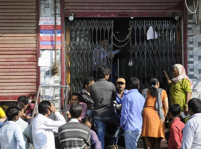 People stand in  queue outside a bank in Noida, Uttar Pradesh on Tuesday, November 22, 2016.
