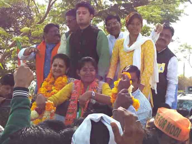 BJP workers celebrate party's win in Indore.