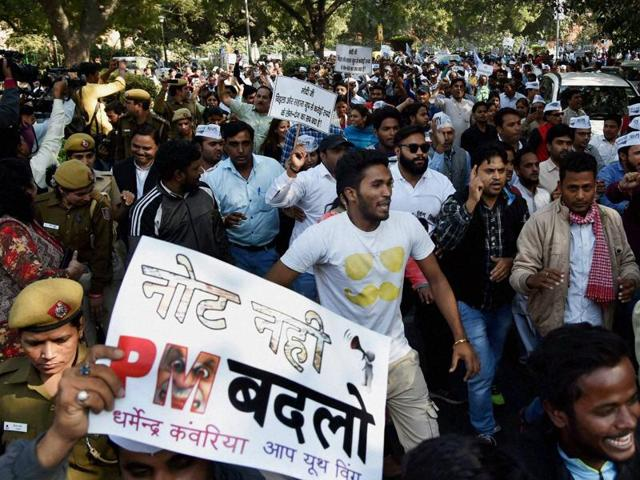 Volunteers of Delhi 's ruling Aam Aadmi Party shout slogans during a protest march against the demonetisation of Rs 500 and Rs 1000 notes, in New Delhi on Tuesday.