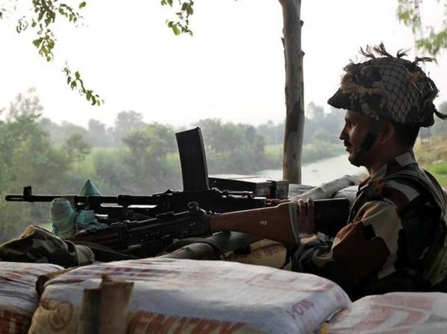 A file photo of Indian army soldier keeping guard from a bunker near the border with Pakistan in Abdullian, southwest of Jammu.