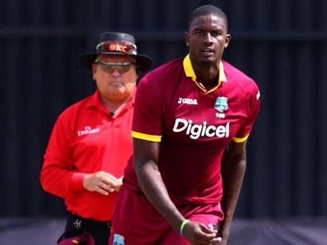 Jason Holder's West Indies will bowl first in a crucial game against Sri Lanka.