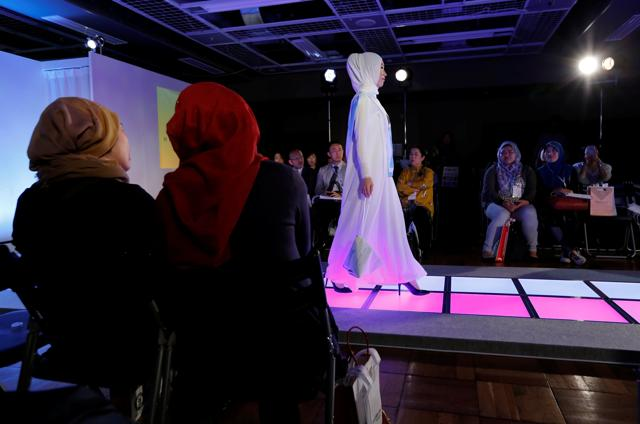 Models wore various designs by popular brands such as Alia Anggunm, Lynn Siregar, Meem Clothings, Weddingku and more during Tokyo Modest Fashion Show. (Toru Hanai/REUTERS)