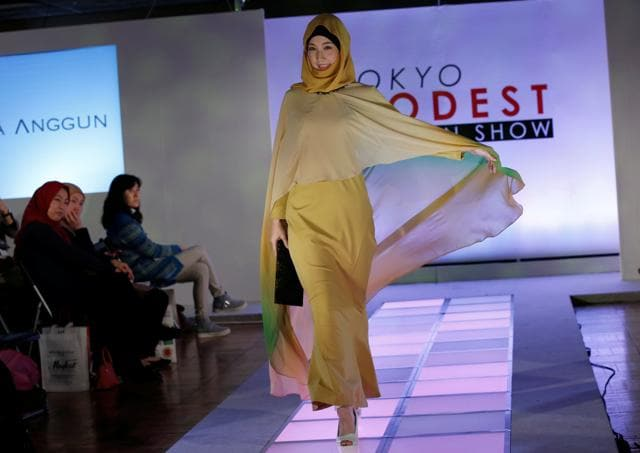 Among popular designs were floral patterns that were adorning long robe garments and matching headscarves. (Toru Hanai/REUTERS)
