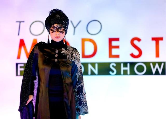 """The show is said to Japan's first """"Muslimah Fashion Show"""" and is taking place as part of a two-day event at the Halal Expo in Japan. (Toru Hanai/REUTERS)"""