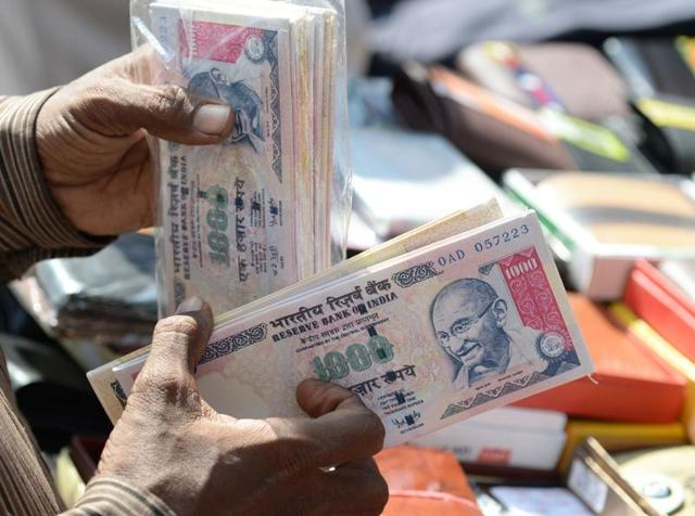 A vendor displays wallets made from replica prints of the demonetised Rs 500 and Rs 1000 notes at a stall in Mumbai.