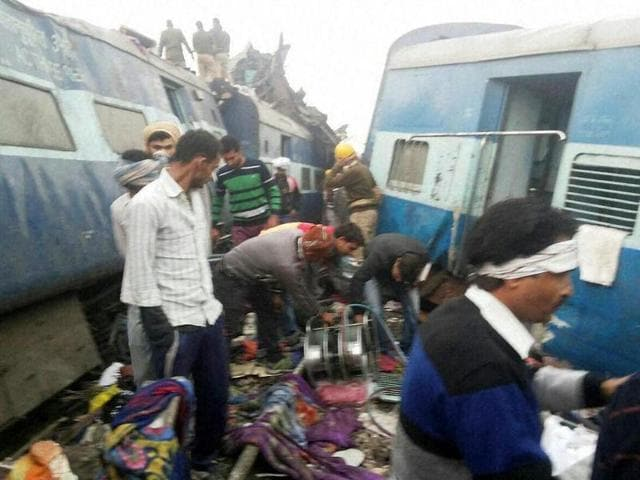 Rescue officials on the spot where 14 coaches of the Indore-Patna Express derailed in Kanpur Dehat.
