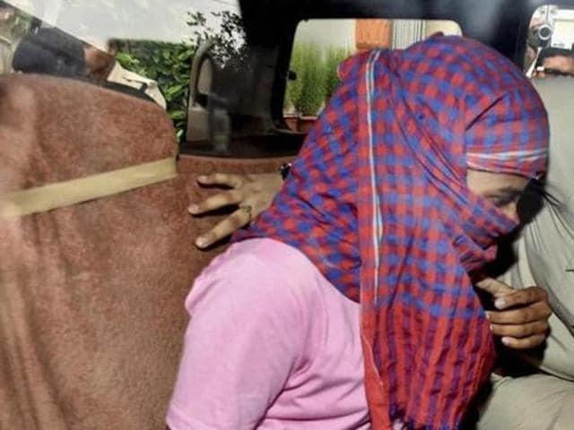 Police arrest Ruby Rai, victim of Bihar School Examination Board higher secondary exam topper scam in Patna.