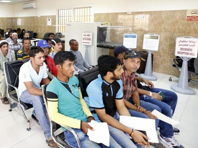 Migrants wait at the Search and Follow up Department, which is processing the claims of those trying to leave as part of an ongoing three-month amnesty for undocumented residents, on November 8, 2016 in the Qatari capital Doha.