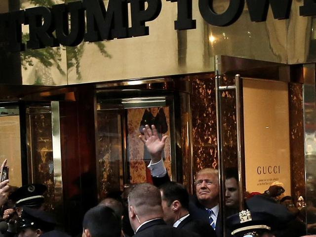 Republican presidential nominee Donald Trump waves to supporters outside the front door of Trump Tower where he lives in the Manhattan borough of New York.(REUTERS)