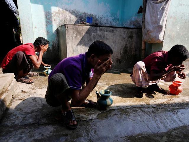 Rohingya Muslim perform ablution before prayer at the unregistered Rohingya Refugee Camp Leda in Teknaf near Cox's Bazar, Bangladesh on Tuesday