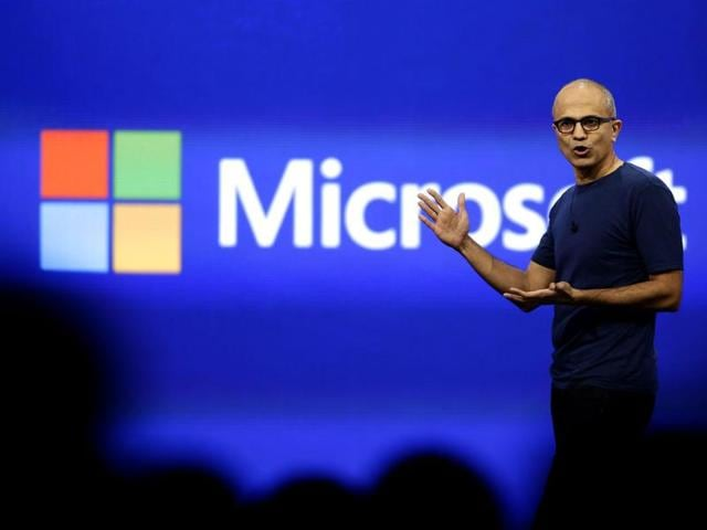 Microsoft CEO Satya Nadella gestures as he speaks during his keynote address in San Francisco, California.