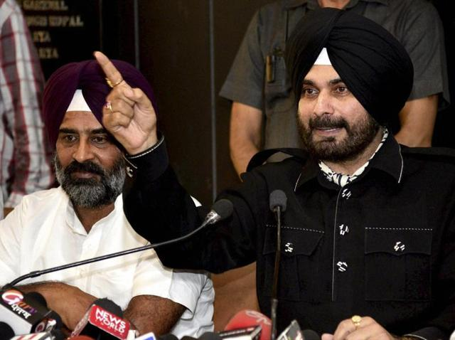 Navjot Singh Sidhu and Pargat Singh at a press conference in Chandigarh.