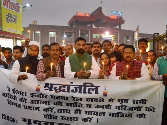 People light candles to pay tributes to victims of Indore-Patna Express train, in Patna on Tuesday.