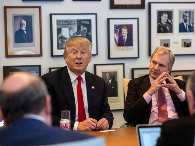 Kellyanne Conway, from left, President-elect Donald Trump, New York Times Publisher Arthur Sulzberger Jr., and vice chairman of The New York Times Company Michael Golden appear during a meeting with editors and reporters at The New York Times building.