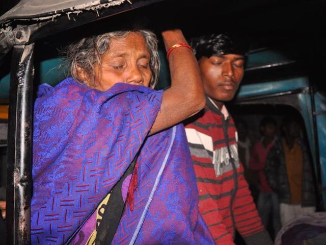 Manju Devi's mother-in-law and husband outside Gaya's Anugrah Narayan Magadh Medical College Hospital .