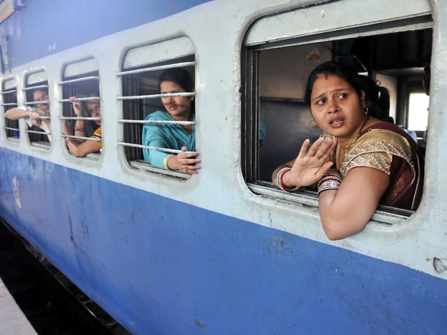 A railway employee checks Indore-Patna Express before departure on Wednesday.