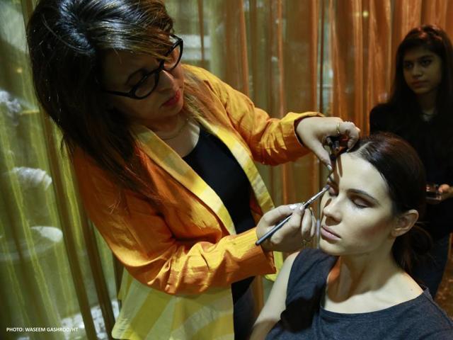 Makeup artist Kanchan Mehra working on a models looks.
