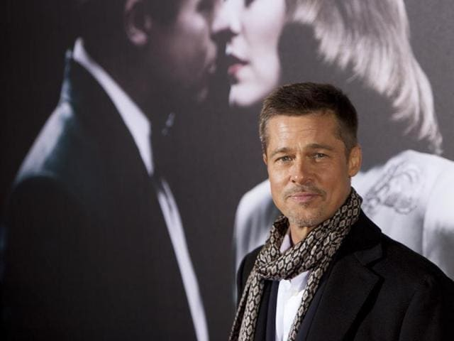 US actor Brad Pitt poses for photographers during a photocall for the premiere of the new film Allied in Madrid, Spain.