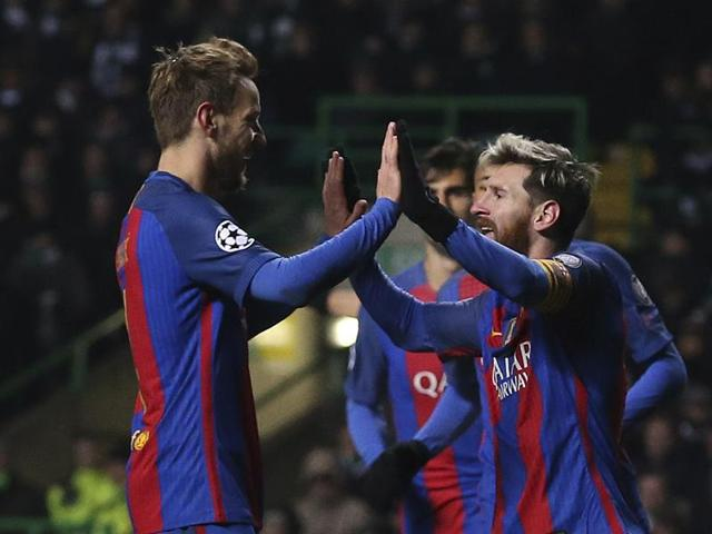 Barcelona's Lionel Messi, right, celebrates with Barcelona's Ivan Rakitic after winning the Champions League Group C soccer match between Celtic and Barcelona at Celtic Park stadium in Glasgow, Scotland, Wednesday, Nov. 23, 2016.(AP Photo/Scott Heppell)