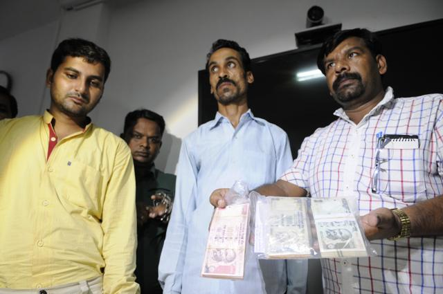 Accused arrested by police for printing and circulating counterfeit currency notes in Bhopal.