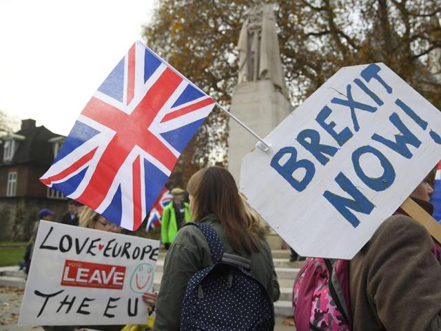 Demonstrators supporting Brexit protest outside of the Houses of Parliament in London, Britain.