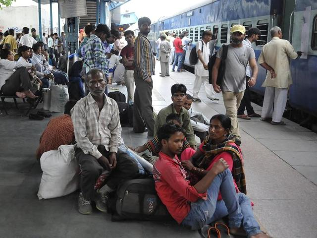 Migrant workers at the railway station in Ludhiana on Thursday.