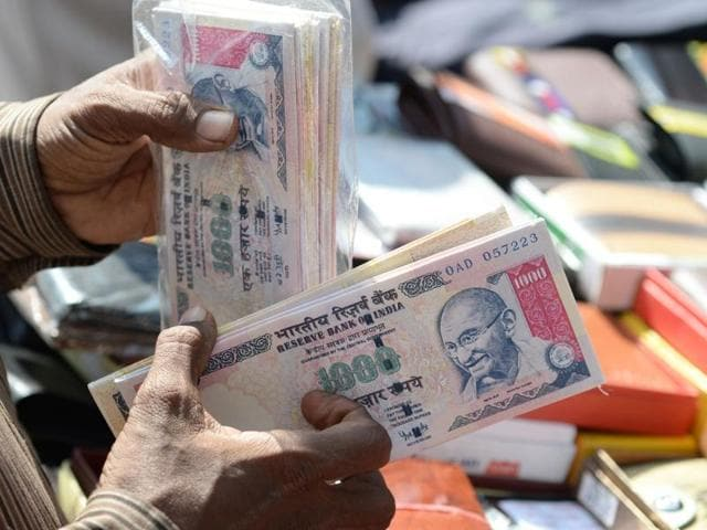 A vendor displays wallets made from replica prints of the demonetised Rs 500 and Rs 1000 notes for sale at a stall in Mumbai.