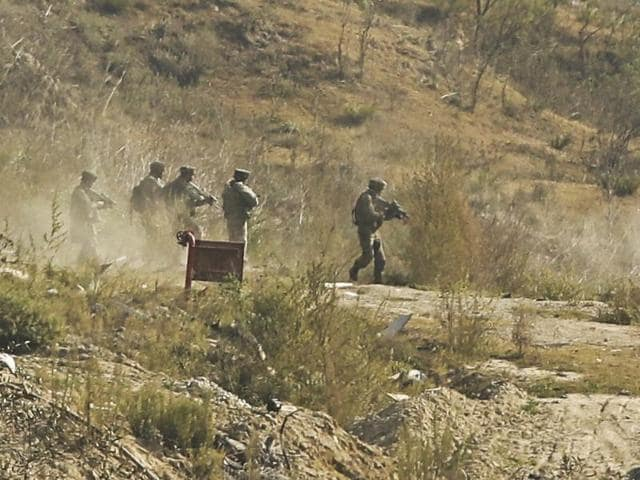 Indian Army during a gun battle in Pampore in Kashmir.