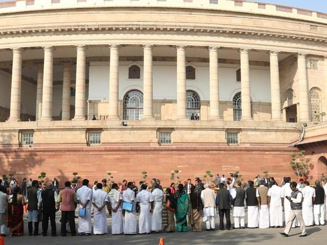 Opposition politicians take part in a protest calling for Prime Minister Narendra Modi to attend Parliament over the ongoing demonetisation process at Parliament House in New Delhi.