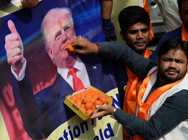 A photograph of Donald Trump is displayed by activists belonging to 'Hindu Sena' in New Delhi.