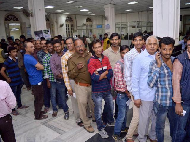 People stand in a queue to exchange their old notes inside a bank in Allahabad on Wednesday.(PTI Photo)