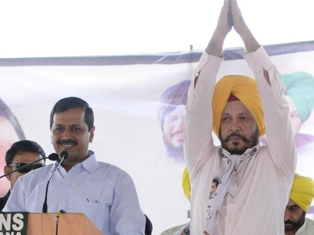 Arvind Kejriwal announces Dr Balbir Singh as the AAP candidate from Patiala (urban) as state affairs in-charge Sanjay Singh (right) looks on, at a rally in Samana in Patiala district on Thursday, November 24.