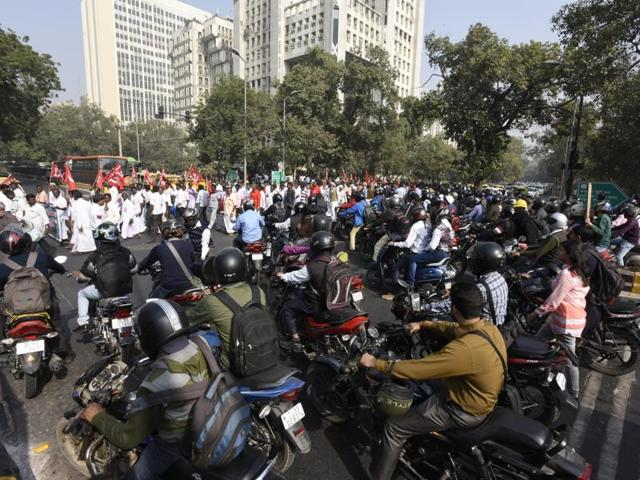 Heavy traffic at KG Marg due to a protest march on Thursday.