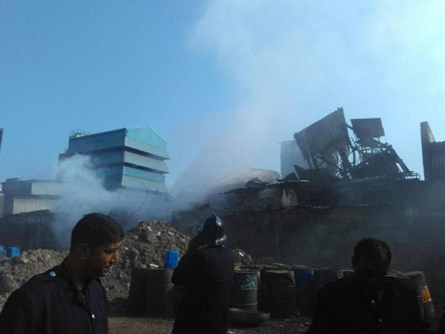 Firemen try to douse the flames at the chemical facoty in Pawane, Navi Mumbai.