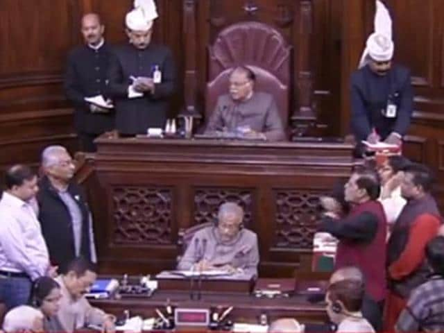 Opposition members protest in the Well, demanding an apology from PMModi for accusing his critics of supporting black money.