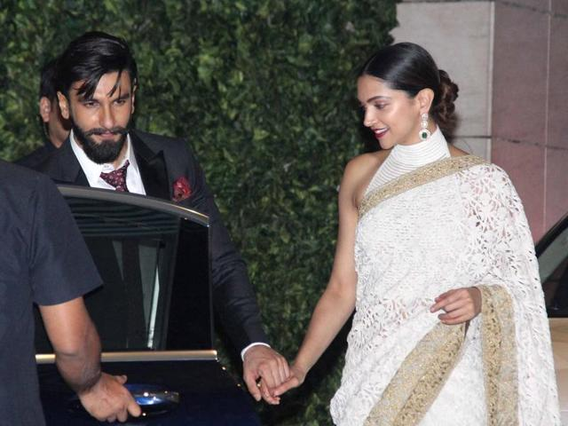 The two were spotted holding hands as they were leaving the Ambanis' party together. Ranveer was seen escorting Deepika to a car with her hand clenched tightly in his.