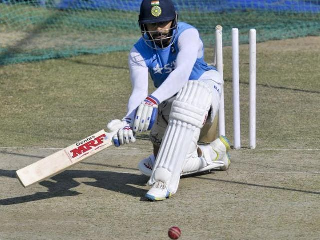 India captain Virat Kohli looked in fine nick and is set to carry on the good form from the second Test in Visakhapatnam. He had an extended session at the nets, and knocked the ball around with near perfect precision and timing. (Ravi kumar/ht photo)