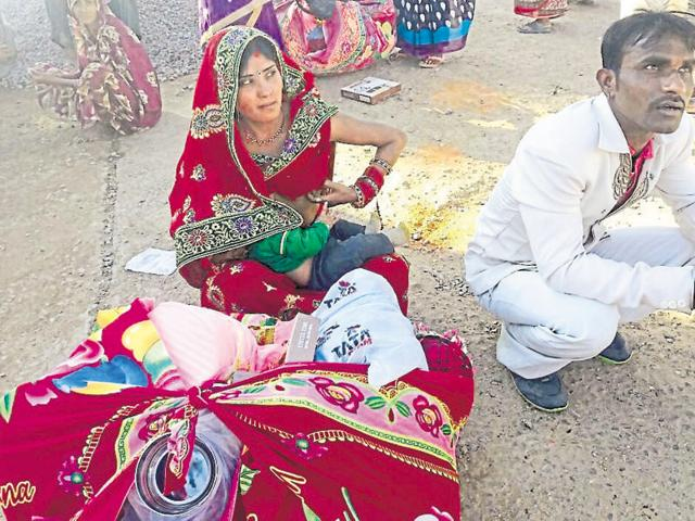 A couple with their baby during the Kanyadan mass marriage ceremony at Chhatarpur on Thursday.