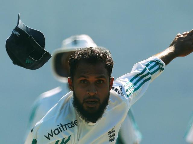 England's Adil Rashid, who is the visiting side's spin spearhead, would be hoping to get among the wickets in Mohali. He tried a few variations while bowling at the nets during the England training session. (REUTERS)