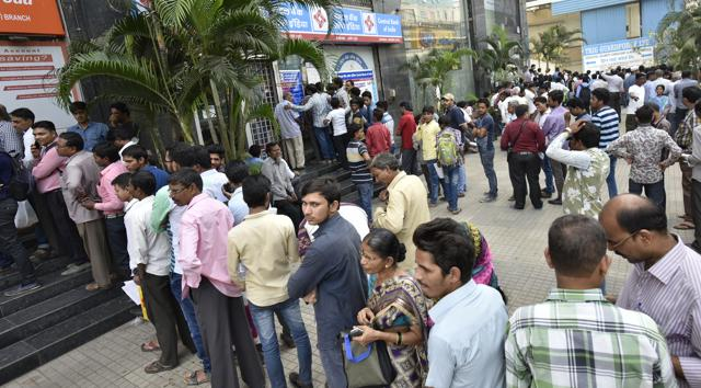 People queue up outside several banks to exchange old Rs500 and Rs1,000 banknotes at Sakinaka in Mumbai.