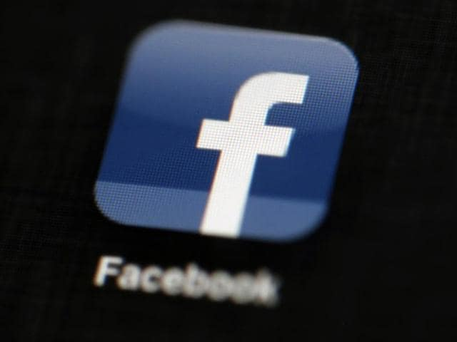 In this May 16, 2012, file photo, the Facebook logo is displayed on an iPad in Philadelphia. Facebook is under fire for failing to rein in fake and biased news stories that some believe may have swayed the presidential election