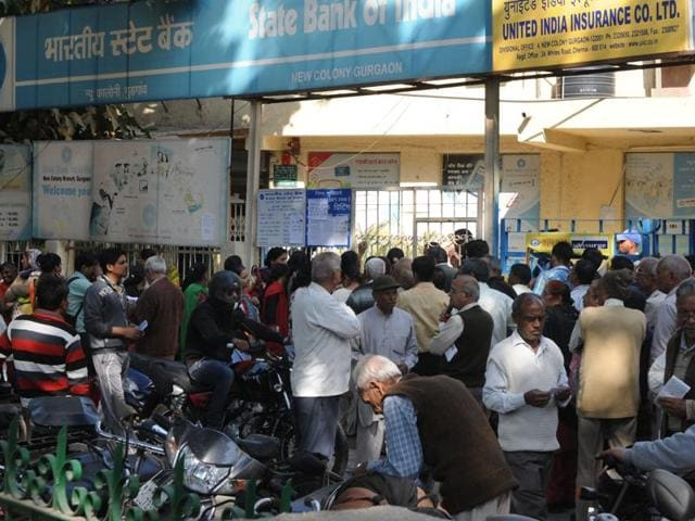 People outside a State Bank of India branch in Gurgaon on Friday.
