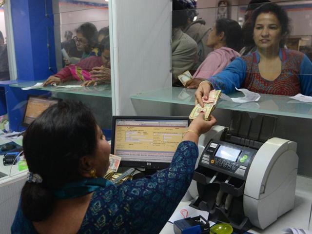 Indian bank customer deposit Rs 500 and Rs 1000 notes at a bank in Amritsar on November 25.