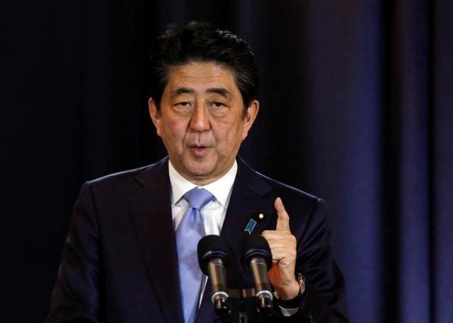 Japanese Prime Minister Shinzo Abe gestures during a press conference in Buenos Aires, Argentina.