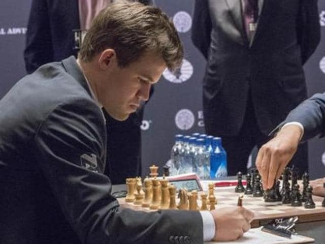 Magnus Carlsen achieved a crucial win against Sergey Karjakin as he levelled the series 5-5 with two games to go.