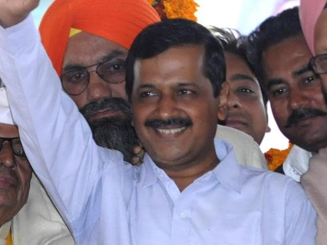(From left) Patiala Urban candidate Dr Balbir Singh, Delhi CM Arvind Kejriwal and AAP workers during a rally at Samana in Patiala on Thursday.